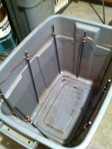 I got a plastic bin and wired up some rods in order to surround the vise.